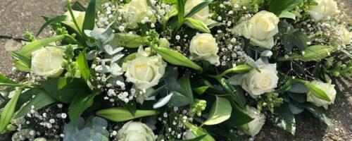 rouw-bloemen-kist-afscheid-afscheidsbloemen
